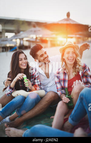 Happy friends partying and having fun on beach at summer - Stock Photo