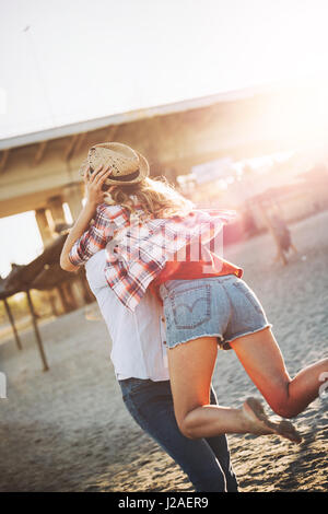Truly happy playful couple in love  having fun at beach - Stock Photo