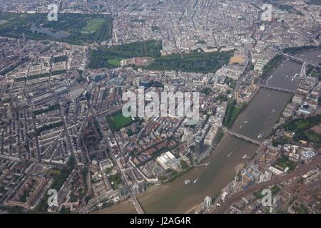Aerial view of London and the River Thames with Buckingham Palace and the Palace of Westminster in view - Stock Photo