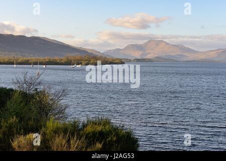 East shoreline of Loch Lomond in Scotland with Ben Lomond on the horizon. - Stock Photo