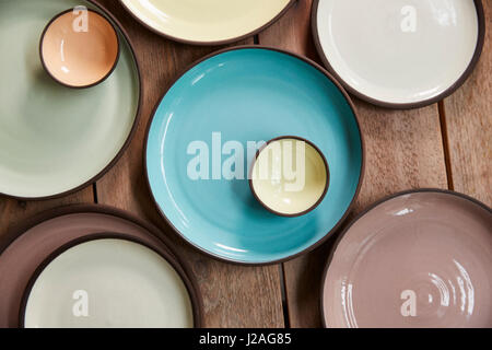 Handmade earthenware on a wooden table, overhead close up - Stock Photo