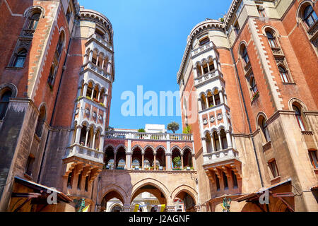 ISTANBUL, TURKEY - JULY 13, 2014:  Two five-storey building and the arch made in Venetian Neo-Gothic style in the - Stock Photo