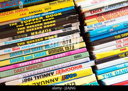 A selection of Childrens comic book annuals in a second hand bookshop, UK - Stock Photo