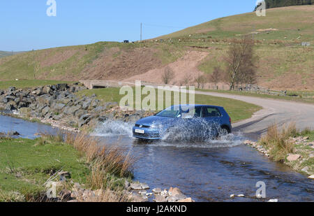 VW Gold TDi crossing ford - Stock Photo