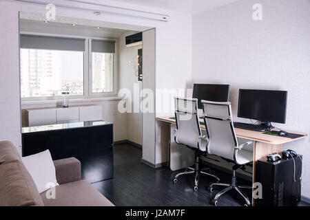 Interior of modern apartment with workplace - Stock Photo