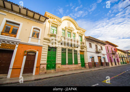 Cuenca, Ecuador - April 22, 2015: Bridgestone roads in city centre with charming and beautiful buildings architecture, - Stock Photo