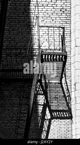 Elegant fire ladder on wall black and white - Stock Photo