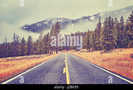 Vintage toned scenic road in autumn, travel concept. - Stock Photo