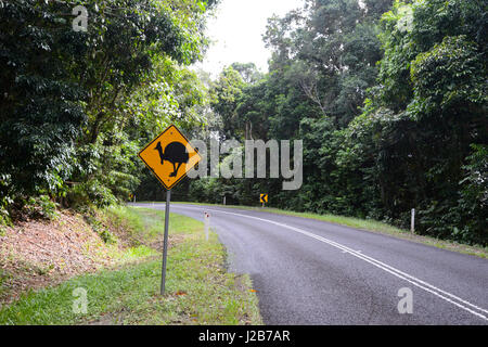 Wildlife road sign warning about cassowaries, near Cairns, Queensland, QLD, Australia - Stock Photo