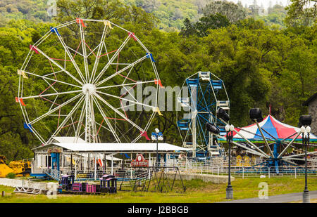 Old Carnival Rides Stored In Wooded Area - Stock Photo