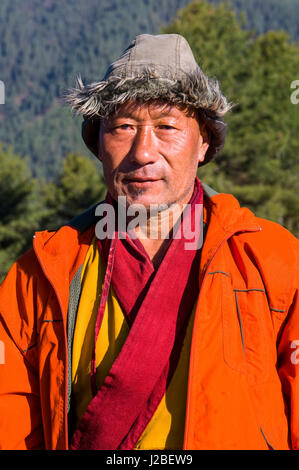 Native man in front of Mountain landscape, Pele La Pass, Bhutan - Stock Photo