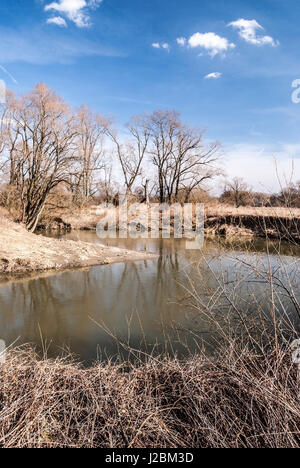 meander of Odra river with trees and blue sky with clouds in early spring CHKO Poodri near Studenka city in Czech - Stock Photo