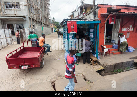 Africa, Sierra Leone, Freetown. People and an idling truck at an intersection. - Stock Photo
