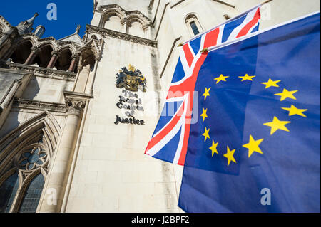 EU European Union and UK United Kingdom flags flying together in front of The Royal Courts of Justice in London, - Stock Photo