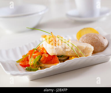 Grouper fillet served with fried garlic an vegetables. - Stock Photo