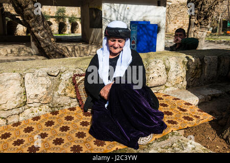 Yazidi woman in Lalish capital of the Kurdish sect of the Yazidis in Iraq, Kurdistan (Large format sizes available) - Stock Photo