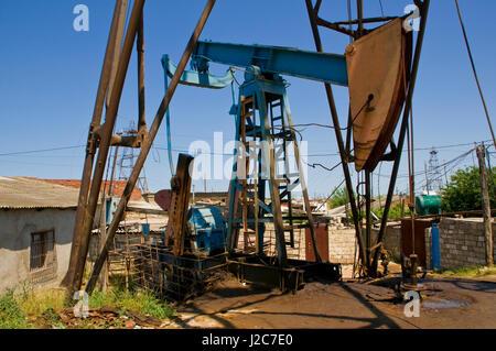 Oil derricks on the shore near Baku Azerbaijan - Stock Photo