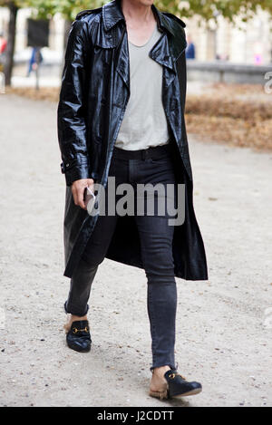 Man in black leather trench coat walking in street, crop - Stock Photo