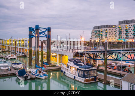 Brighton, England. 13 April 2017.Boats, yachts, and fishing boats moored at Brighton Marina docs on a cloudy day. - Stock Photo