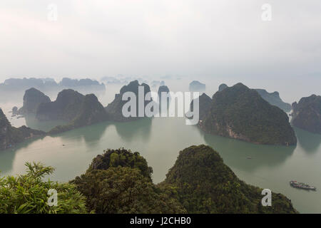 View over misty Ha Long Bay, north Vietnam - Stock Photo