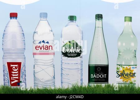 Saint Georges, France - February 10, 2017: Bottled water brands ad in France on a wall - Stock Photo