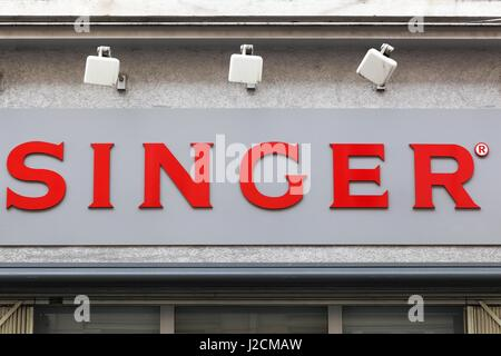 Villefranche, France - March 13, 2017: Singer logo on a wall. Singer is an American manufacturer of sewing machines - Stock Photo