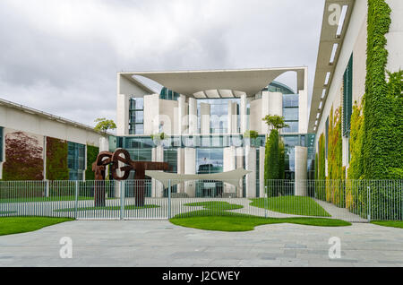 Berlin, Germany - August 14, 2016: The German Federal Chancellery, main seat since 2001,  surrounded by plants in - Stock Photo