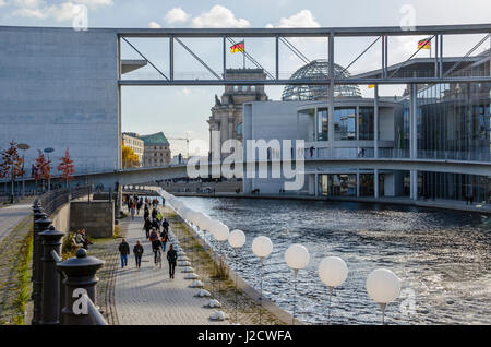 Berlin, Germany - November 8, 2014: People celebrating 25 Years Fall of the Wall.Thousand illuminated balloons along - Stock Photo
