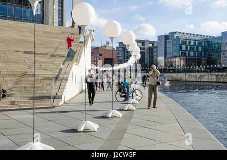 Berlin, Germany - November 8, 2014: People celebrating 25 Years Fall of the Wall.Thousand illuminated balloons along - Stock Photo