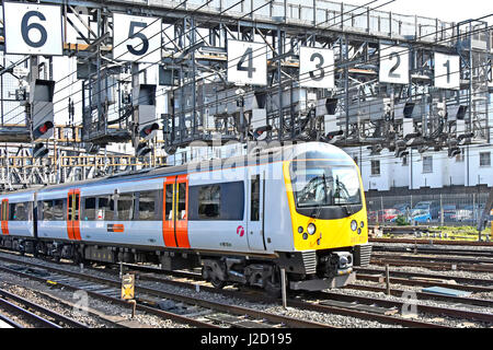 A first great western heathrow connect train passing through heathrow connect train carriages just after depart paddington for london heathrow airport uk below signal sciox Choice Image