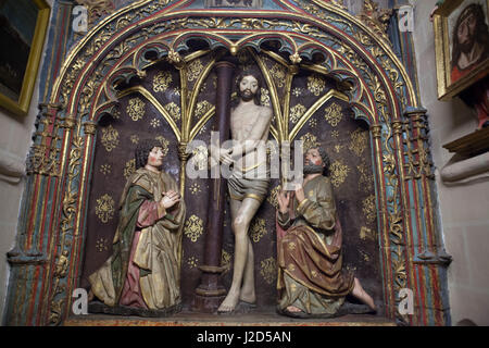 Christ at the Column. Gothic altarpiece from ca. 1469 in the Capilla del Cristo de la Columna (Chapel of Christ - Stock Photo