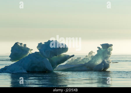 Canada, Nunavut Territory, Ukkusiksalik National Park, Melting sea ice floating in Hudson Bay on summer evening - Stock Photo
