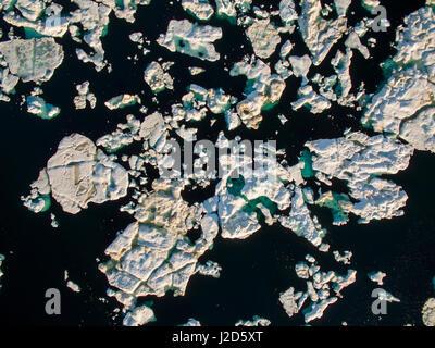 Canada, Nunavut Territory, Ukkusiksalik National Park, Aerial view of melting sea ice floating near mouth of Wager - Stock Photo