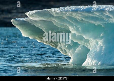 Canada, Nunavut Territory, Ukkusiksalik National Park, Summer sun light melting iceberg in Wager Bay - Stock Photo