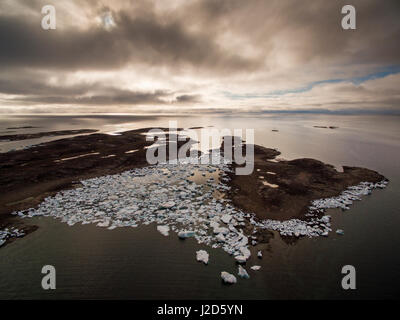 Canada, Nunavut Territory, Repulse Bay, Aerial view of grounded icebergs on Harbor Islands on summer morning - Stock Photo