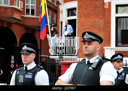 The founder of Wikileaks, Julian Assange addresses his supporters from the balcony of the Ecuadorian embassy in - Stock Photo