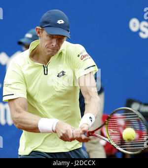 Barcelona, Spain. 27th Apr, 2017. South African tennis player Kevin Anderson hits the ball against Spanish Rafael - Stock Photo