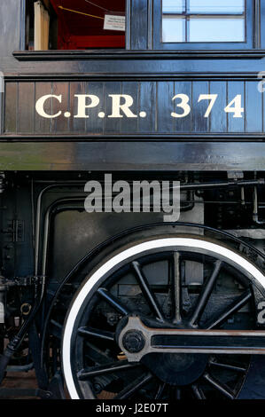 Drive wheel and cab of the Restored CPR Engine 374 at the Roundhouse in Yaletown, Vancouver, British Columbia, Canada. - Stock Photo