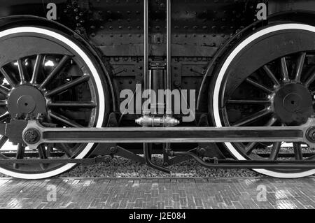 Close-up of the drive wheels  of the Restored CPR Engine 374 at the Roundhouse in Yaletown, Vancouver, British Columbia, - Stock Photo