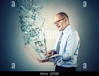 Water coming out of businessman's laptop - Stock Photo