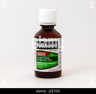Bottle of Robitussin isolated on white. - Stock Photo
