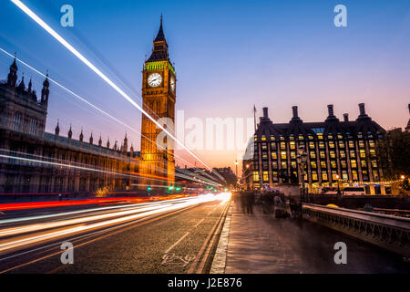 Light trails in front of Big Ben, dusk, evening light, sunset, Houses of Parliament, Westminster Bridge, City of - Stock Photo