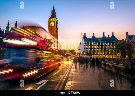 Red double decker bus in front of Big Ben, dusk, evening light, sunset, Houses of Parliament, Westminster Bridge - Stock Photo