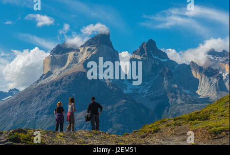 Tourists watching over the horns of the Paine massive with the use of Bokeh inside the Torres del Paine national - Stock Photo