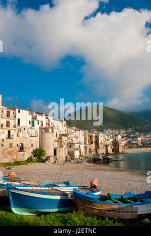 Boats on beach, Cefalu, N coast, Sicily - Stock Photo