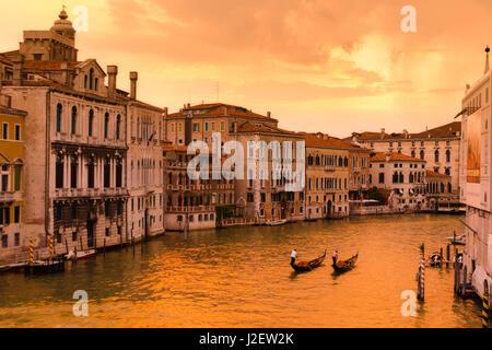 Evening light and gondolas on the Grand Canal, Venice, Veneto, Italy - Stock Photo