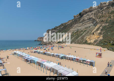 Portugal, Nazare, striped cabanas on beach (Large format sizes available) - Stock Photo