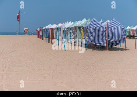Europe, Portugal, Nazare, striped cabanas on beach - Stock Photo