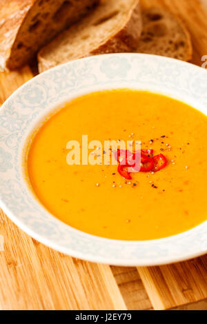 Lentil and red bell pepper soup with coconut milk - Stock Photo
