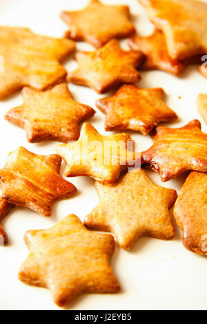 Cakes and biscuits with star shape on white background